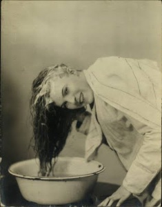 woman washing hair in bowl